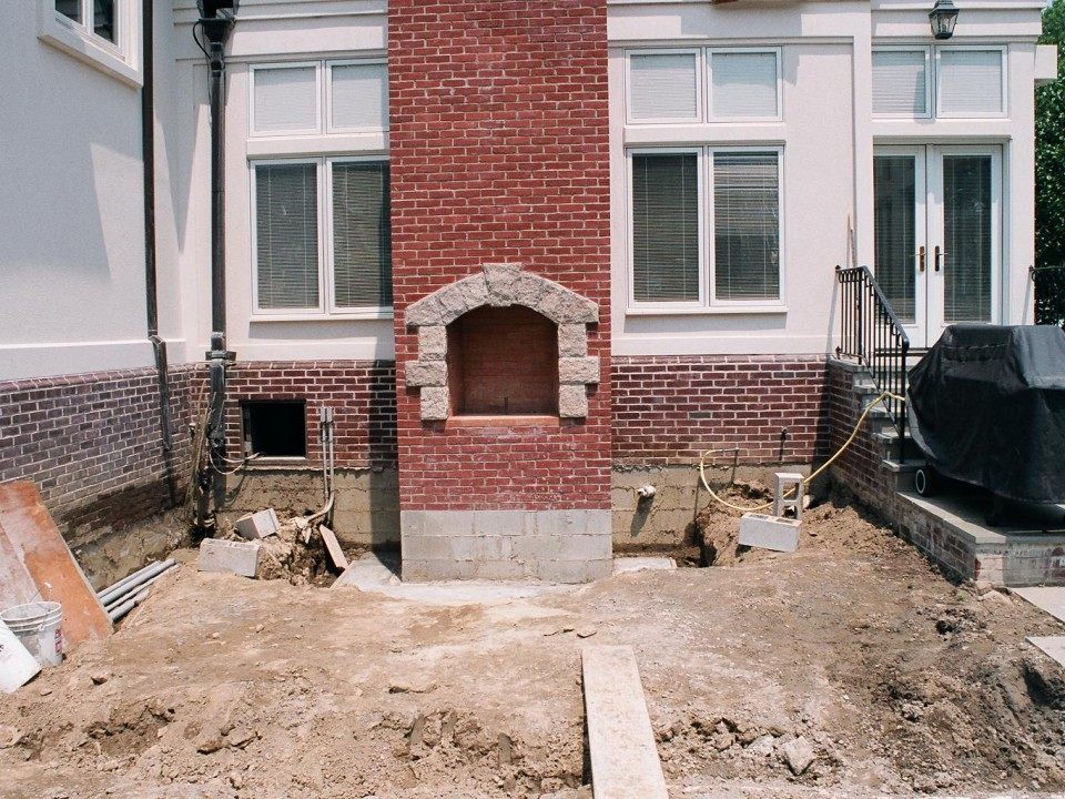 Outdoor fireplace during construction phase