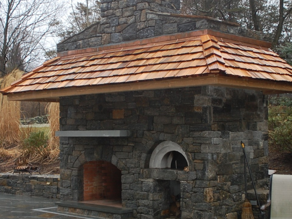 Stone fireplace with pizza oven