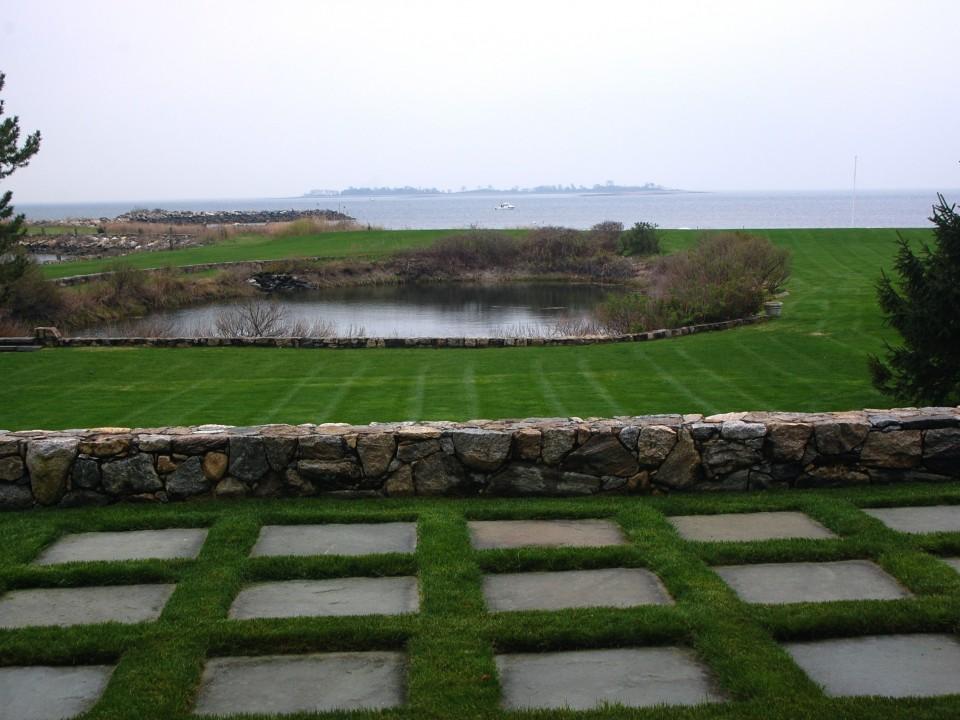 Bluestone and sod with fieldstone retaining wall