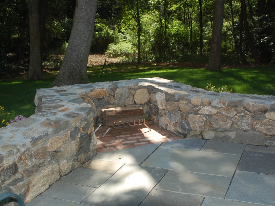 Stone wall with fireplace niche