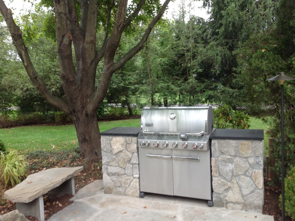 Grill niche using existing grill with granite countertops and fieldstone walls